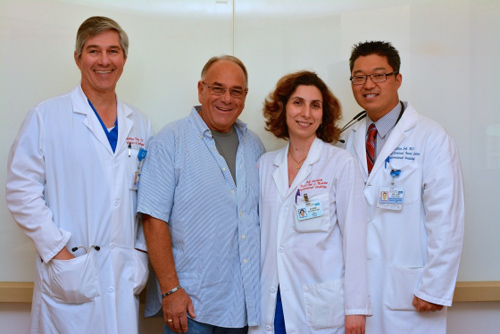 Marty Greenfield with UCLA doctors. Marty Greenfield (second from left) with members of the UCLA team at a follow-up visit a week after the patient's procedure at Ronald Reagan UCLA Medical Center. From left to right: Dr. Jonathan Tobis, Greenfield, Dr. Rubine Gevorgyan and Dr. William Suh. Not pictured: Dr. Ali Nsair, another essential member of Greenfield's medical team. Image credit: University of California