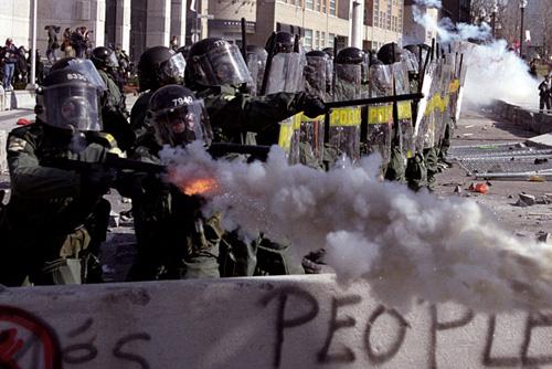 Police fire tear gas. Image source: Wikipedia