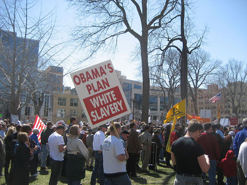 """Sign from Madison, WI Tea Party. Sign Says """"Obama's Plan White Slavery"""".  Author: cometstarmoon (Image source: Wikipedia)"""