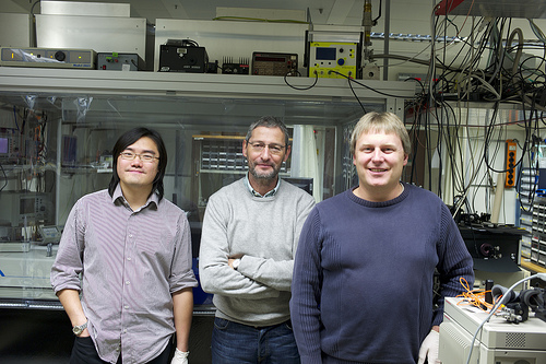 For the first time, scientists at IBM Research have demonstrated a complex quantum mechanical phenomenon known as Bose-Einstein condensation (BEC) using non-crystalline solid materials.The discovery was made using a luminescent polymer (plastic) similar to the materials in light emitting displays used in many of today's smartphones. This discovery has potential applications in developing novel optoelectronic devices including energy-efficient lasers and optical switches — critical components for future computer systems. The use of a polymer material and the observation of BEC at room temperature provides substantial advantages in terms of applicability and cost. In this photo, the team of IBM scientists (left to right) Lijian Mai, Rainer F Mahrt and Thilo Stoeferle who achieved the Bose-Einstein condensate breakthrough. Photo Credit: IBM Research