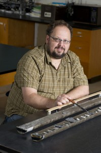Geologist Liviu Giosan analyzes a sediment core in his lab at Woods Hole Oceanographic Institution.(Photo by Tom Kleindinst, Woods Hole Oceanographic Institution)