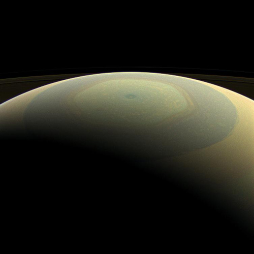 The globe of Saturn, seen here in natural color, is reminiscent of a holiday ornament in this wide-angle view from NASA's Cassini spacecraft. Image Credit: NASA/JPL-Caltech/Space Science Institute