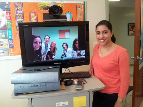 Fit for Healthy Weight telehealth station. UCLA's Kaizeen Mody (standing) with (onscreen, left to right) Nilufar Izadpanah, Masako Horino, Danyale McCurdy, Wendy Slusser and Dena Herman at UCLA's Fit for Healthy Weight telehealth station. Image credit: University of California