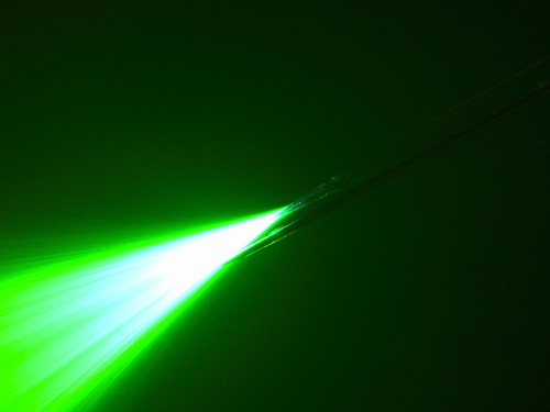Optrode or electrode? This hair-thin combination of electrode and optical fiber allows researchers to deliver stimulating light and current to a neuron and to measure the electrical activity of each. Image credit: Sheinberg lab/Brown University