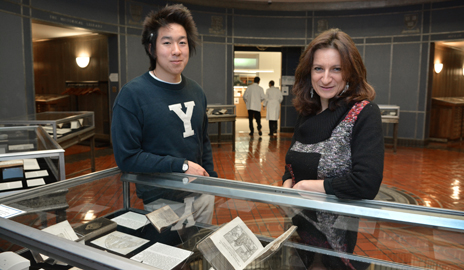 "Professor Paola Bertucci and Cyrus Nguyen '15 at the exhibit ""Books of Secrets: Alchemy, Medicine, and Magic"" that her students curated as part of their midterm assignment for her seminar. (Photo by Michael Marsland)"