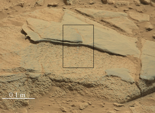 """The rock """"Ithaca"""" shown here, with a rougher lower texture and smoother texture on top, appears to be a piece of the local sedimentary bedrock protruding from the surrounding soil in Gale Crater. NASA's Curiosity Mars rover used its Mast Camera (Mastcam) to take this image during the 439th Martian day, or sol, of Curiosity's work on Mars (Oct. 30, 2013). Image Credit: NASA/JPL-Caltech/MSSS"""