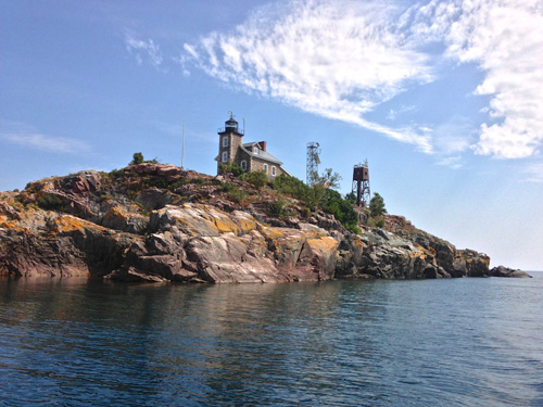 Granite Island Light Station, Lake Superior. The nearby belltower, far right, hosts one of five year-round Great Lakes evaporation monitoring stations. Image credit: John Lenters