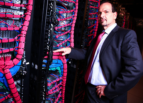 IBM SoftLayer CEO Lance Crosby examines servers at the IBM SoftLayer data center in Dallas, Texas, on Friday, January 17, 2014. IBM announced it is committing more than $1.2 billion to significantly expand its global network of cloud data centers. (Image credit: Ron Jenkins/Feature Photo Service for IBM)