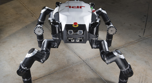 """The Jet Propulsion Laboratory's official entry, RoboSimian, awaits the first event at the DARPA Robotics Challenge in December 2013. Also known as """"Clyde,"""" the robot is four-footed but can also stand on two feet. It has four general-purpose limbs and hands capable of mobility and manipulation. Image credit: JPL-Caltech"""