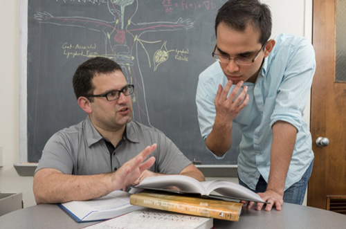 Ryan Zurakowski (left), shown with doctoral student Fabian Cardozo, is co-author of a paper appearing in Nature Medicine highlighting the role of T-cells in HIV. Photo by Kathy F. Atkinson