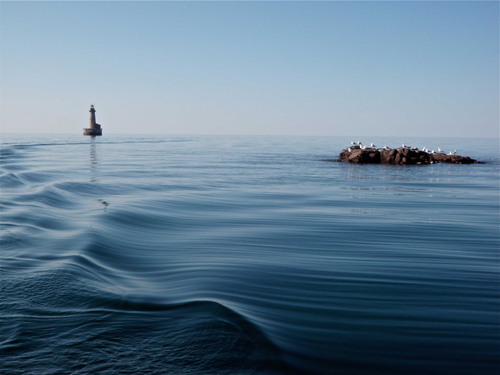 Stannard Rock Light, Lake Superior. The lighthouse hosts one of five year-round Great Lakes evaporation monitoring stations. Image credit: John Lenters
