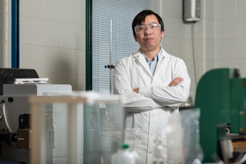 A UD engineering research team led by Feng Jiao has developed a highly selective catalyst capable of electrochemically converting carbon dioxide to carbon monoxide with 92 percent efficiency. Photo by Evan Krape and illustration courtesy of Feng Jiao