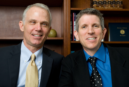 "UCLA professors Thomas Bradbury (left) and Benjamin Karney, authors of ""Love Me Slender: How Smart Couples Team Up to Lose Weight, Exercise More, and Stay Healthy Together."" Image credit: University of California"