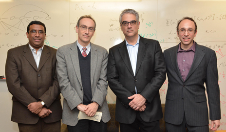 YINS faculty in residence Sekhar Tatikonda, associate professor of electrical engineering & statistics; University Provost Benjamin Polak; and YINS co-directors Nicholas Christakis, the Sol Goldman Family Professor of Social and Natural Science, and Daniel Spielman, the Henry Ford II Professor of Computer Science and Mathematics. (Photo by Michael Marsland)
