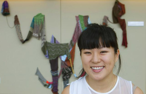 """Youbin Kang and Banglatie. """"I had this idea of one outfit that connects several different people. It's a way of showing how we are all connected by the process of making clothing,"""" Image credit: Brown University"""