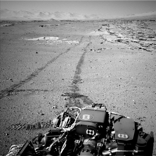 Curiosity's View Back After Passing 'Junda' Striations. NASA's Curiosity Mars rover used the Navigation Camera (Navcam) on its mast for this look back after finishing a drive of 328 feet (100 meters) on the 548th Martian day, or sol, of the rover's work on Mars (Feb. 19, 2014). Image credit: NASA/JPL-Caltech