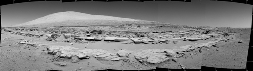 Martian Landscape With Rock Rows and Mount Sharp. This landscape scene photographed by NASA's Curiosity Mars rover shows rows of rocks in the foreground and Mount Sharp on the horizon. Image credit: NASA/JPL-Caltech
