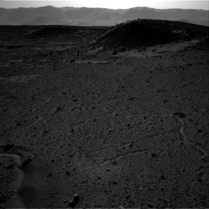 This image from the Navigation Camera (Navcam) on NASA's Curiosity Mars rover includes a bright spot near the upper left corner. Image credit: NASA/JPL-Caltech (Click image to enlage)