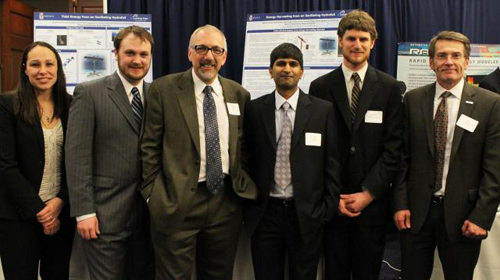 The hydrofoil team presents findings in Washington, D.C. From left: Jennifer Franck, lecturer in engineering; Michael James Miller, grad student; Kenneth Breuer, professor of engineering; Shreyas Mandre, professor of engineering and team leader; Benjamin Strom, research engineer; and Bryan Willson, a program director at the Advanced Research Projects Agency-Energy (ARPA-E). Image credit: Brown University