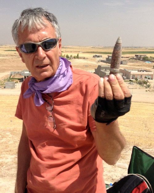 Abbas Alizadeh, senior research associate at the Oriental Institute, holds a piece of spent ammunition from the top of the mound of Surezha. The mound, located in the Erbil province of northern Iraq, had been used as an antiaircraft emplacement during the Iran-Iraq war. Image courtesy of Gil Stein/Oriental Institute