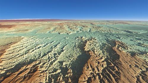 """Dieses dreidimensionale Höhenmodell der Radarsatelliten-Mission TanDEM-X zeigt den Badlands-Nationalpark im Südwesten South Dakotas, eine für Landwirtschaft denkbar ungeeignete Verwitterungslandschaft, daher der Name Badlands (schlechtes Land). Der Film """"Der mit dem Wolf tanzt"""" mit Kevin Costner in der Hauptrolle wurde 1990 zu großen Teilen im Nationalpark und dessen Umgebung gedreht. Image credit: DLR"""