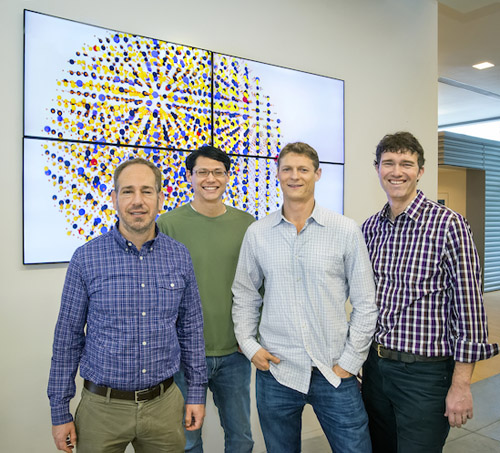 From left Bruce Cohen, Emory Chan, Dan Gargas and Jim Schuck led a study at the Molecular Foundry to develop ultra-small, ultra-bright nanoprobes that should be a big asset for biological imaging, especially imaging neurons in the brain. (Photo by Roy Kaltschmidt)