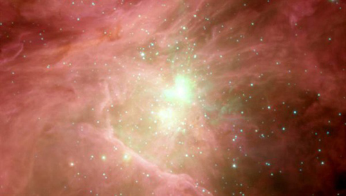 Das Bild zeigt eine Aufnahme des NASA-Satelliten Spitzer vom Orionnebel. Sie zeigt eindruckvoll das turbulente Geschehen in diesem Konglomerat von jungen Sternen und den Gas- und Staubwolken, aus dem sich diese Sterne gebildet haben und auch heute noch bilden. Bei einer der ersten Beobachtungsflüge hat FIFI-LS auch diese aktive Sternentstehungsgebiet beobachtet. Image credit: NASA/Spitzer Observatorium/Thomas Megeath.