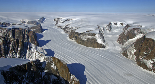 A glacier in the Sukkertoppen ice cap, southwest Greenland, flows down a rocky canyon like those mapped in this study. Image credit: NASA
