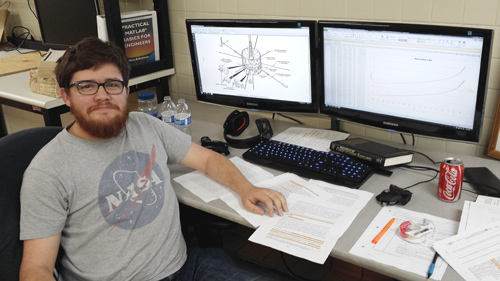 UA engineering student Jacob Gold is writing computer code that will help make contact with the spacecraft. Image credit: University of Arizona