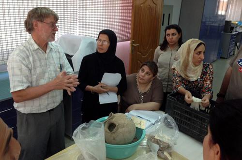 Project ceramics specialist Dr. John Alden discusses the Surezha-excavated ceramics with Iraqi conservators in Erbil. Image courtesy Gil Stein/Oriental Institute