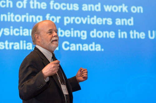 """William H. Woodall delivers a lecture on """"Monitoring and Improving Surgical Quality."""" Photo by Evan Krape"""