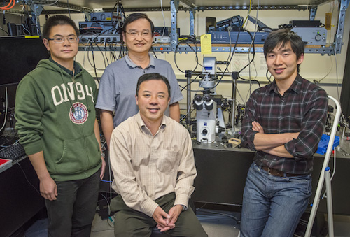 (From left) Yu Ye, Xiaobo Yin, Xiang Zhang and Ziliang Ye used second-harmonic generation imaging to discover strong nonlinear optical resonance along the edges of single layers of molybdenum disulfide. (Photo by Roy Kaltschmidt)