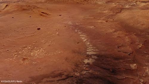 Die perspektivische Darstellung auf der Grundlage der mit den HRSC-Stereobilddaten erzeugten digitalen Geländemodelle lässt gut die an den östlichen Abhängen des Atlantis-Becken (im Hintergrund) und einer kleineren Senke im Süden zu Tage tretenden Schichtköpfe erkennen. Die hellen Ablagerungen stammen von wasserhaltigen Tonmineralen. Image credit: ESA/DLR/FU Berlin.