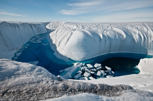 Greenland ice canyon filled with melt water in summer 2010. Image credit: Ian Joughin, UW APL Polar Science Center