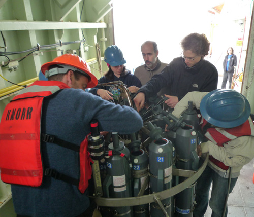 The study's lead author Patrick Martin (second from right) and WHOI marine chemist Ben Van Mooy (left) with their colleagues working around a water sampling rosette. (Photo courtesy of Ben Van Mooy, Woods Hole Oceanographic Institution)