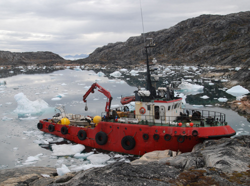 The M/V Viking Madsalex, which was used to collect the oceanic measurements for this study in 2011 and 2012, in Sermilik Fjord, near the terninus of Helheim Glacier. (Photo by William Ostrom, Woods Hole Oceanographic Institution)