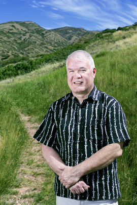 Geophysicist Phil Wannamaker, of the Energy & Geoscience Institute at the University of Utah, stands in the foothills above the campus. Wannamaker conceived and co-authored a new study providing the clearest look yet at the underground system that generates molten rock where two of Earth's tectonic plates collide, then sends it upward to the magma chamber beneath 14,410-foot Mount Rainier, the tallest volcano in the Cascade Range and in Washington state. Photo Credit: Nick Steffens, University of Utah Marketing and Communications
