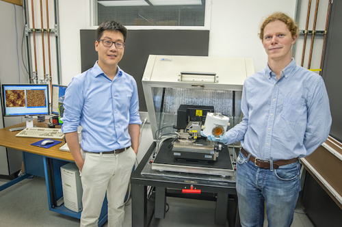 Joseph Kao and Kari Thorkelsson helped devise a technique whereby self-assembling nanoparticle arrays can form a highly ordered thin film over macroscopic distances in one minute. (Photo by Roy Kaltschmidt)