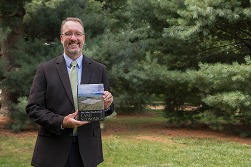 The University of Delaware's Josh Duke is a co-editor of an Oxford University Press handbook focused on land economics. Photo by Lindsay Yeager
