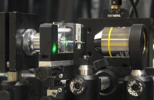 University of Utah engineers have developed a new microscopy method that uses a fine needle or cannula and an LED light to make 3-D images. They hope this new microscope technology, shown here, can be implanted into the brains of mice to show images of cells. Photo Credit: Ganghun Kim, University of Utah