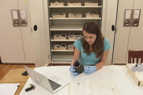 A MU researcher studies ancient Roman artifacts. Image credit: Nic Benner