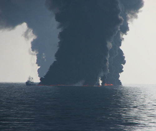 Controlled burning of surface oil slicks during the Deepwater Horizon event. (Photo by Dave Valentine, UCSB)