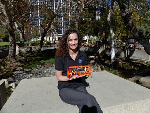 Carolyn Parcheta, a postdoctoral fellow at NASA's Jet Propulsion Laboratory, plans to take this robot, VolcanoBot 2, to explore Hawaii's Kilauea volcano in March 2015. Image credit: NASA/JPL-Caltech