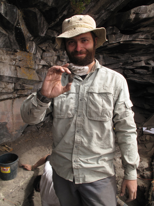 David Reid, a member of the archaeology team, holds up a projectile point fragment left behind by the first known high-altitude settlers. (Photo courtesy of Kurt Rademaker)