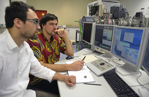 Geologists Adam Sarafian (left) and Horst Marschall working in the Northeast National Ion Microprobe Facility.(Photo by Jayne Doucette, Woods Hole Oceanographic Institution)
