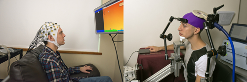 In this photo, UW students Darby Losey, left, and Jose Ceballos are positioned in two different buildings on campus as they would be during a brain-to-brain interface demonstration. The sender, left, thinks about firing a cannon at various points throughout a computer game. That signal is sent over the Web directly to the brain of the receiver, right, whose hand hits a touchpad to fire the cannon. Image credit: Mary Levin, U of Wash.