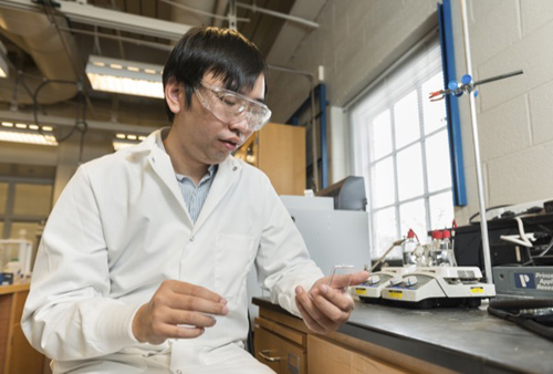 Feng Jiao and researchers at UD and Columbia University have discovered a cheap and efficient catalyst for converting water to hydrogen fuel. Photo by Evan Krape