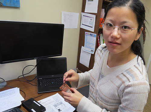 Yinyu Liu, first author of the study and a graduate student in Princeton's Department of Physics, holds a prototype of the device. (Photo by Catherine Zandonella, Office of the Dean for Research)