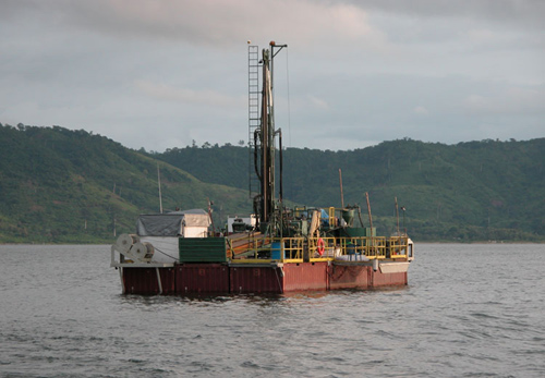 The GLAD800 drilling platform acquiring long sediment cores from the Lake Bosumtwi impact crater during ICDP/NSF funded drilling operations in 2004. (Photo courtesy of Tim Shanahan)