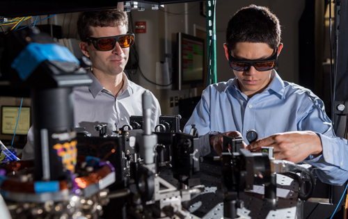 GTRI scientists work in an optical lab developing improved ion traps that could be used in quantum computing. Shown, from left, are research scientists Jason Amini and Nicholas Guise. Image credit: Rob Felt
